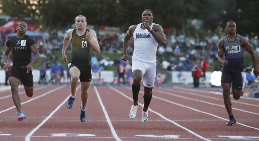 Madison senior Kenan Christon wins the 100-meter dash at the state championships in Clovis.