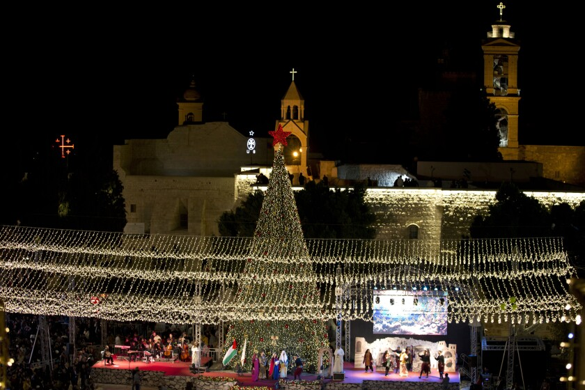 Palestinian Christians celebrate the lighting of a Christmas tree
