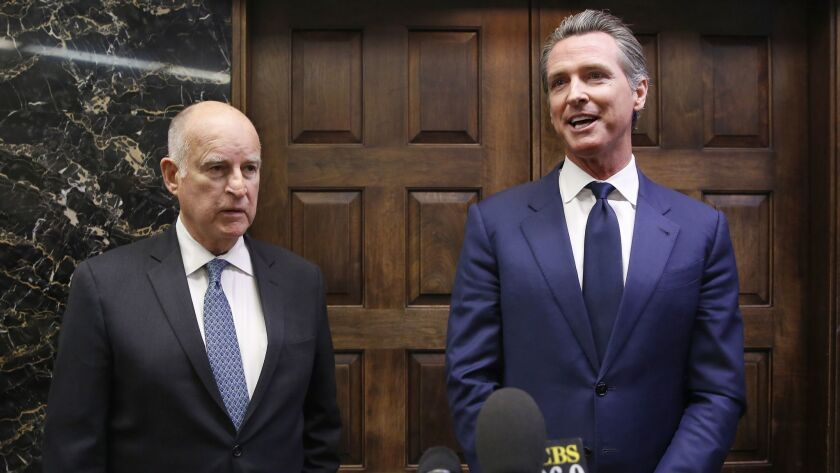 Jerry Brown and Gavin Newsom in November after Newsom was elected governor. Newsom likes to swing for the fences as a politician; the cautious Brown played the percentages.