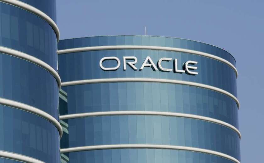 The husband of an Oracle Corp. employee is accused of trading on inside information he learned from his wife's work telephone calls.