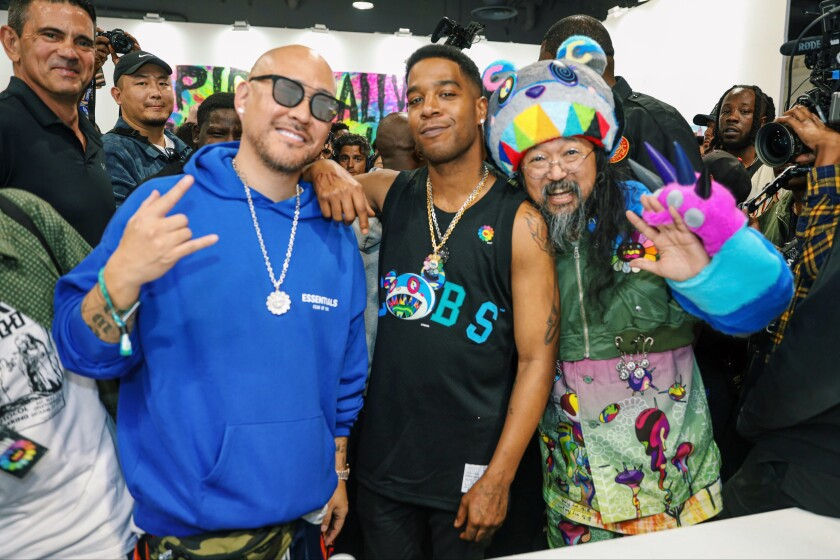 Ben Baller, from left, Kid Cudi and Takashi Murakami at ComplexCon in Long Beach.