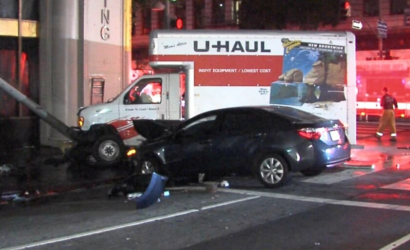 The driver of a U-Haul truck veered onto a downtown sidewalk early Sunday, hitting two vehicles and injuring 10 people at a Los Angeles intersection teeming with Halloween revelers, police said.