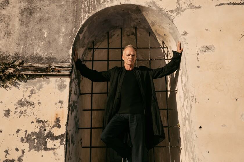 Sting stands in an alcove.
