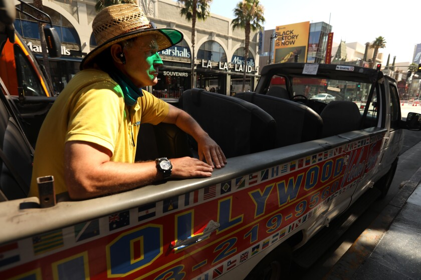 Marty Minogue, 63, manager of Hollywood Value Tours, sits in an empty car that he used to give tours on Hollywood Boulevard.