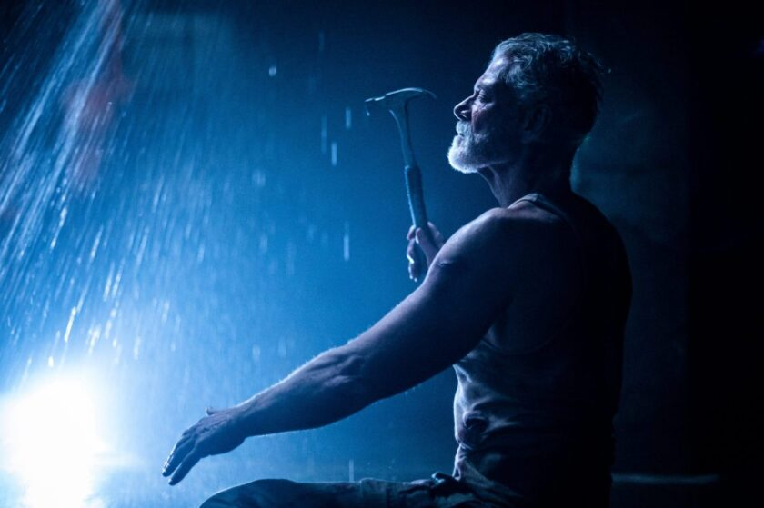 """Stephen Lang holds a hammer in a scene from the film """"Don't Breathe 2."""""""