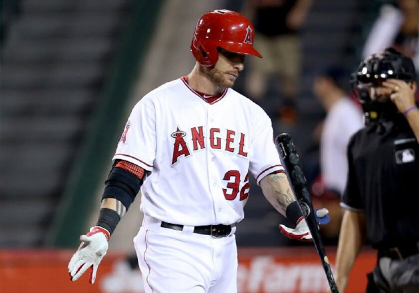 Angels' Josh Hamilton tosses his bat after striking out against the Baltimore Orioles.