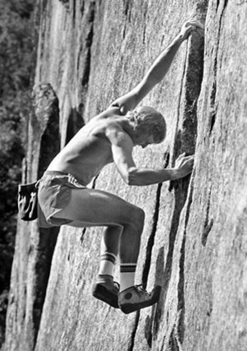 John Bachar climbs a 200-foot rock near Yosemite Valley in 1984, using no ropes.