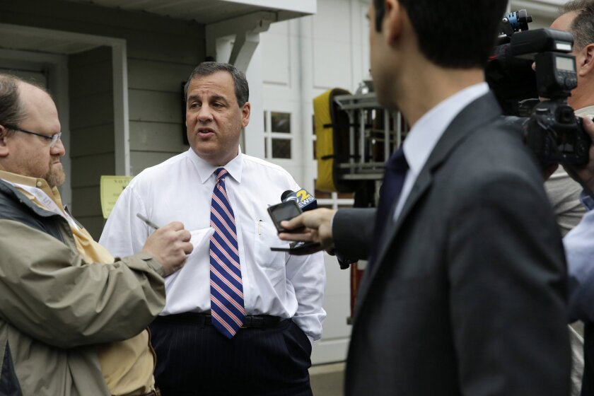 New Jersey Gov. Chris Christie, center, stops to answer questions after he voted on June 2 in Mendham Township, N.J.