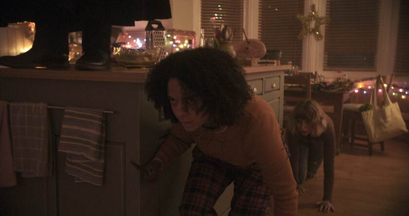 "Aleyse Shannon, left, and Imogen Poots in ""Black Christmas."""