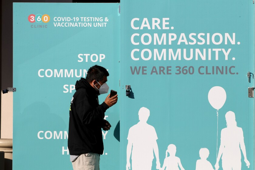 A man checks in for a free COVID-19 test at a walk-up kiosk at the Costa Mesa Senior Center on Saturday.
