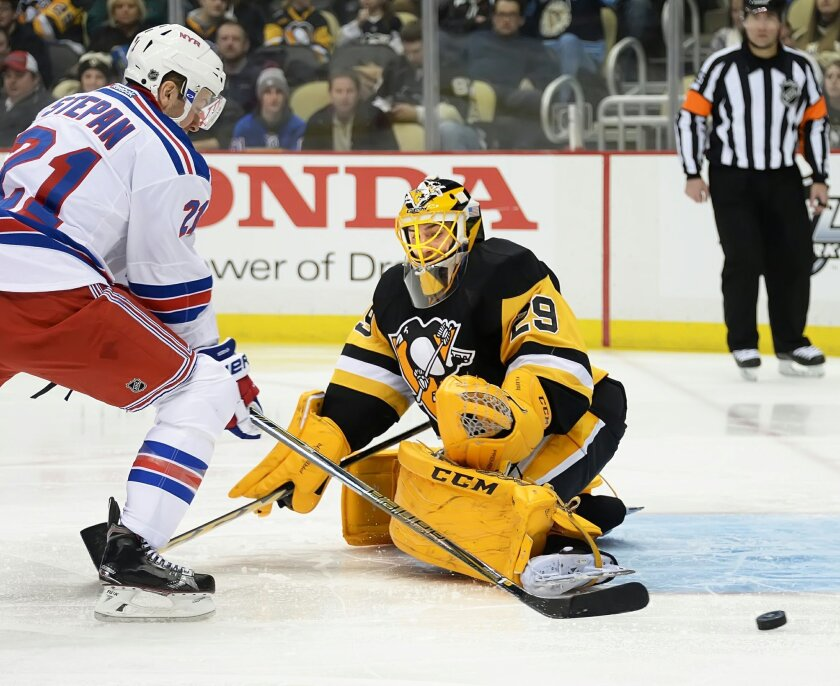 Pittsburgh Penguins Marc-Andre Fleury makes save against the New York Rangers Derek Stepan during an NHL hockey game, Wednesday, Feb. 10, 2016 in Pittsburgh. (Peter Diana/Pittsburgh Post-Gazette via AP) MAGS OUT; MONESSEN OUT; KITTANNING OUT; CONNELLSVILLE OUT; GREENSBURG OUT; TARENTUM OUT; NORTH H