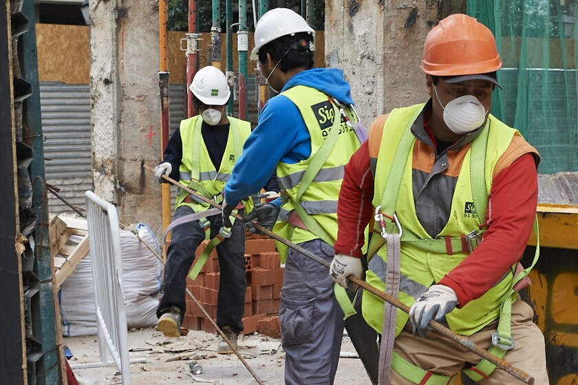 Construction workers return to work as the government eases coronavirus restrictions in Madrid.