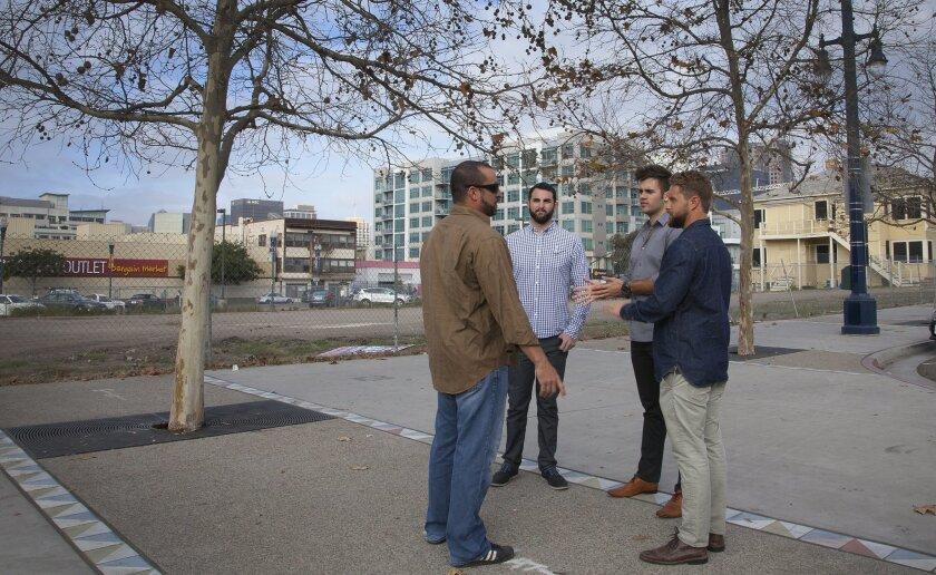 Left-to-right, Adam Jubela, David Loewenstein, Phillip Auchettl and Jason Grauten chat on the corner lot they hope to develop into their Rad Lab Quartyard.