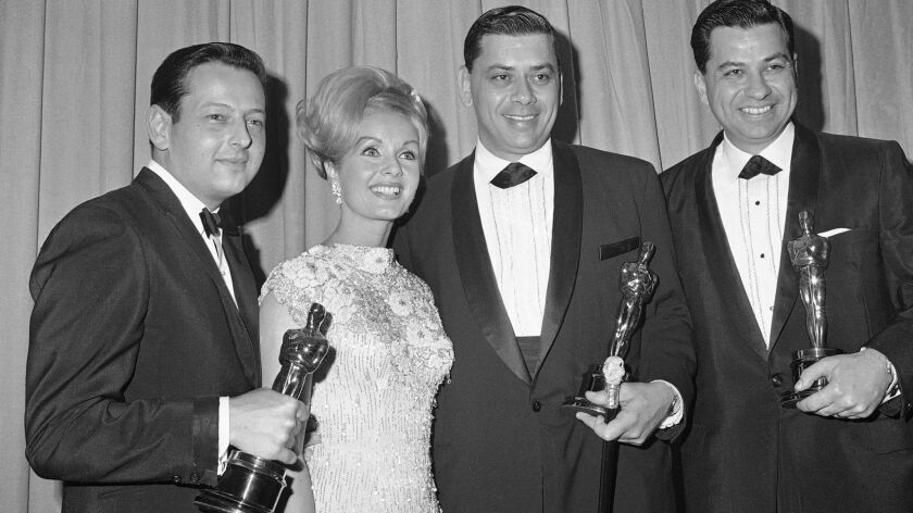 Actress Debbie Reynolds shown with the musical winners at the Academy Awards presentations in Santa