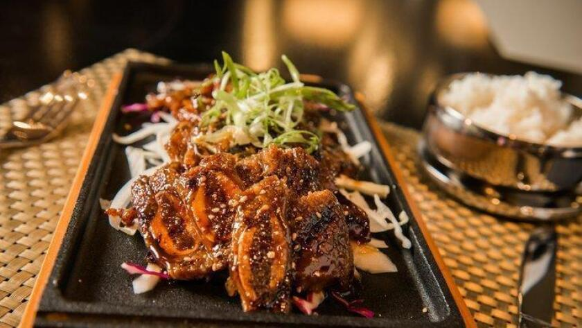 BBQ galbi, or short ribs over onions, at Saja Korean Kitchen in San Diego's Gaslamp Quarter.
