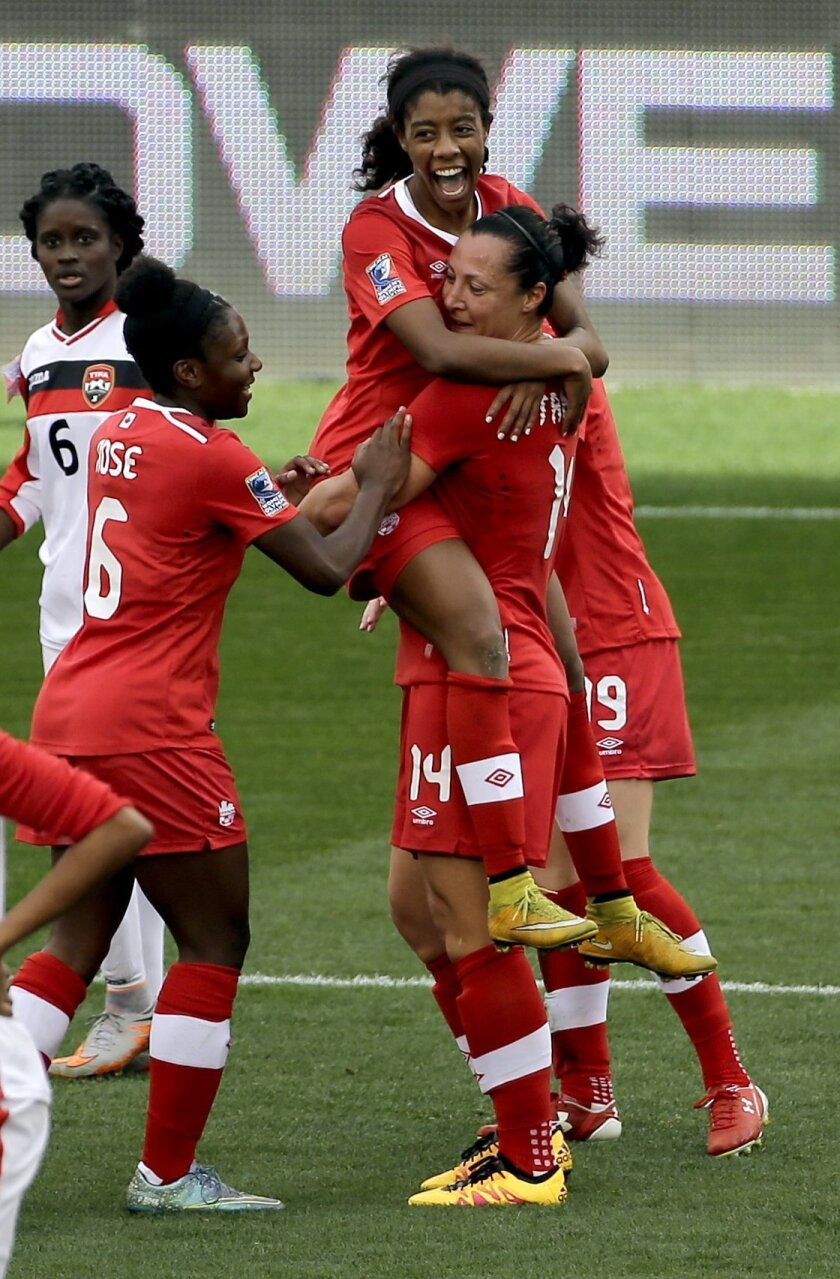 Canada's Melissa Tancredi (14) celebrates her goal while holding Ashley Lawrence as Deanne Rose (6) joins in during the first half of a CONCACAF Olympic qualifying tournament soccer match against Trinidad & Tobago Sunday, Feb. 14, 2016, in Houston. (AP Photo/David J. Phillip)