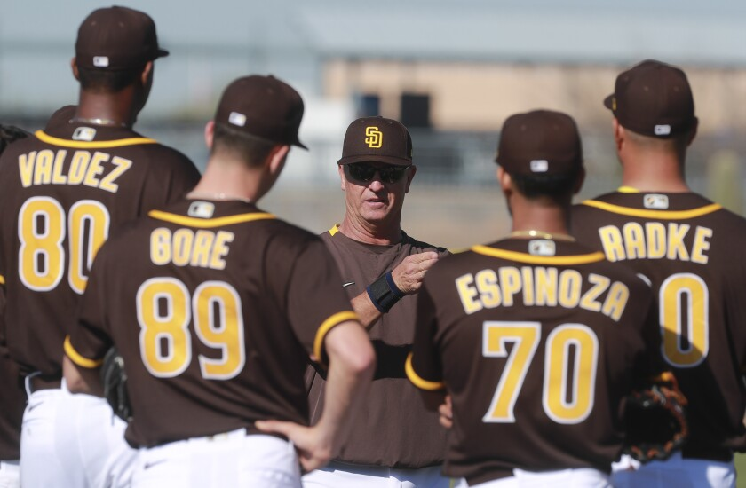 Padres coach Bobby Dickerson instructs pitchers during a spring training workout.
