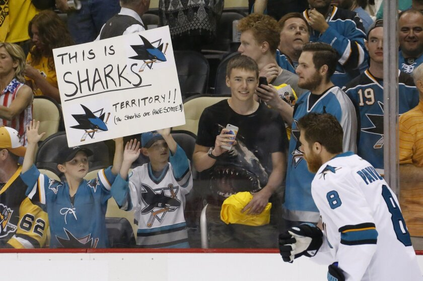 San Jose Sharks fans cheer as captain Joe Pavelski skates past before Game 1 of the Stanley Cup final series between the San Jose Sharks and the Pittsburgh Penguins Monday, May 30, 2016, in Pittsburgh. (AP Photo/Keith Srakocic)