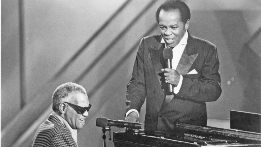 "Ray Charles and Lou Rawls  during the annual ""Evening of Stars"" fundraiser for the United Negro College Fund."