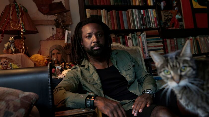 Marlon James being photobombed by a bookstore cat in Harlem.