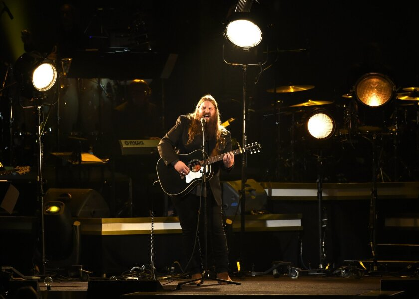 "Chris Stapleton performs ""Lady"" at the MusiCares Person of the Year tribute honoring Lionel Richie at the Los Angeles Convention Center on Saturday, Feb. 13, 2016. (Photo by Chris Pizzello/Invision/AP)"