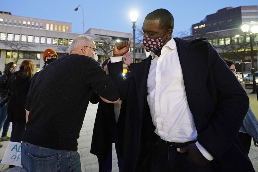 Rep.-elect Mondaire Jones, right, bumps elbows with a supporter Wednesday in White Plains, N.Y.