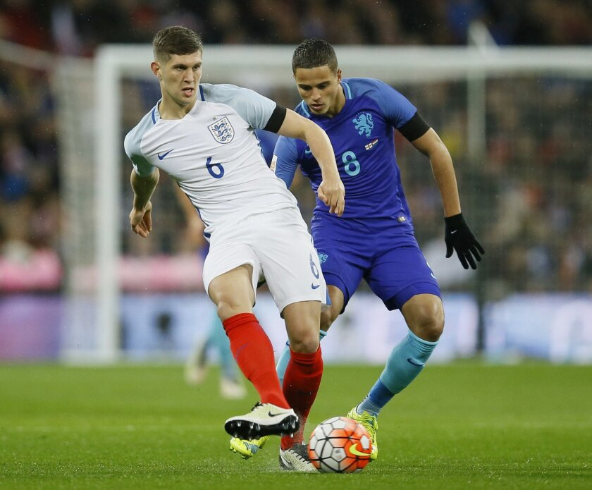 England's John Stones, left, and Netherlands' Ibrahim Affelay vie for the ball during the international friendly soccer match between England and The Netherlands at Wembley stadium in London, Tuesday, March 29, 2016. (AP Photo/Kirsty Wigglesworth)