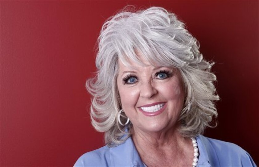 FILE - In this Tuesday, Jan. 17, 2012 photo, celebrity chef Paula Deen poses for a portrait in New York.  A month after being widely criticized for revealing she has diabetes, as well as a lucrative endorsement deal for a drug to treat it, Paula Deen says she's ready to show a lighter side to her f