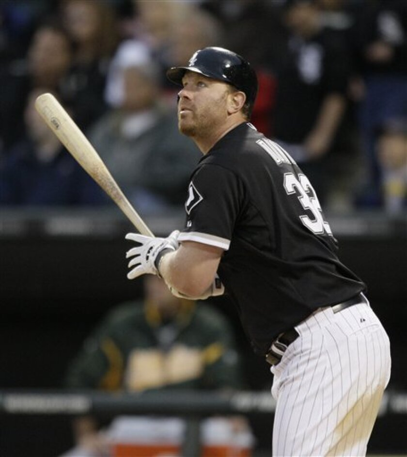 Chicago White Sox's Adam Dunn watches his two-run home run against the Oakland Athletics during the third inning of a baseball game in Chicago, Thursday, June 9, 2011. (AP Photo/Nam Y. Huh)