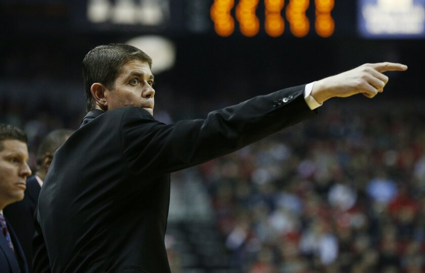 UNLV head coach Dave Rice motions to his players during the first half of an NCAA college basketball game against Arizona State Wednesday, Dec. 16, 2015, in Las Vegas. (AP Photo/John Locher)