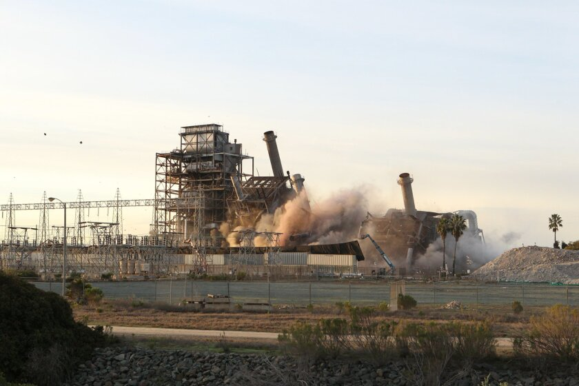 Early Saturday morning workers from Oakland-based Silverado Contractors performed the $40 million demolition on the South Bay Power Plant which was decommissioned in 2010.