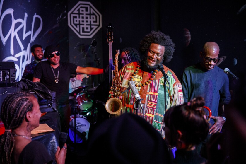 Musician Kamasi Washington performs with the saxophone at The World Stage on Thursday, June 21, 2018