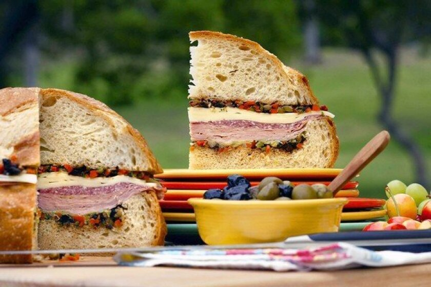 Packed with deli meat and pickled vegetables, the muffuletta is a portable meal-in-one that's ideal for sharing.