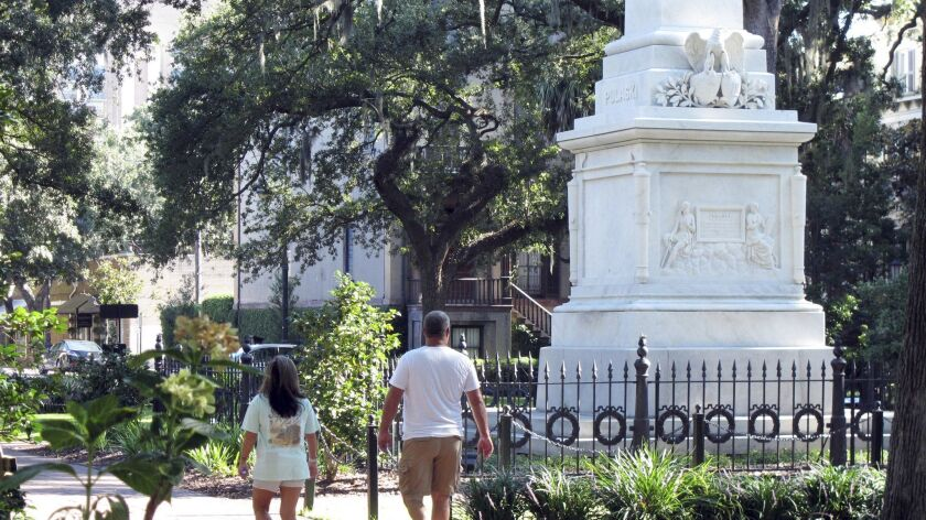 People stroll through historic Monterey Square in Savannah, Ga.