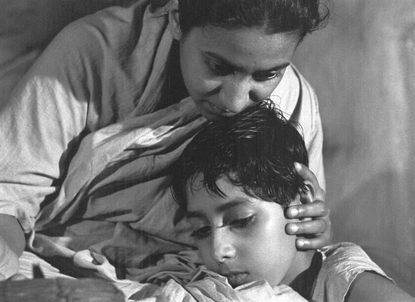 "Pinaki Sengupta as Apu and Karuna Banerjee as Apu's mother, Sarbajaya, in Satyajit Ray's ""Aparajito,"" part of the Apu Trilogy."