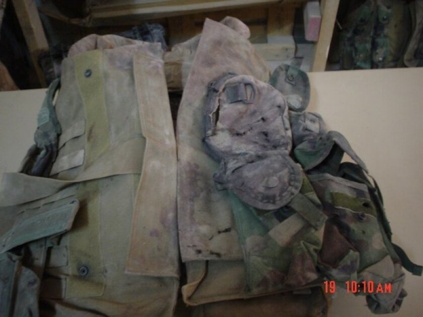 Sgt. Rafael Peralta's flak vest is emblematic of widely divergent conclusions over material and witness evidence in the Navy's failed push for a Medal of Honor for the fallen Marine. Supporters point to blast damage on the left pectoral area of the vest as proof that a low-yield Iraqi grenade was u
