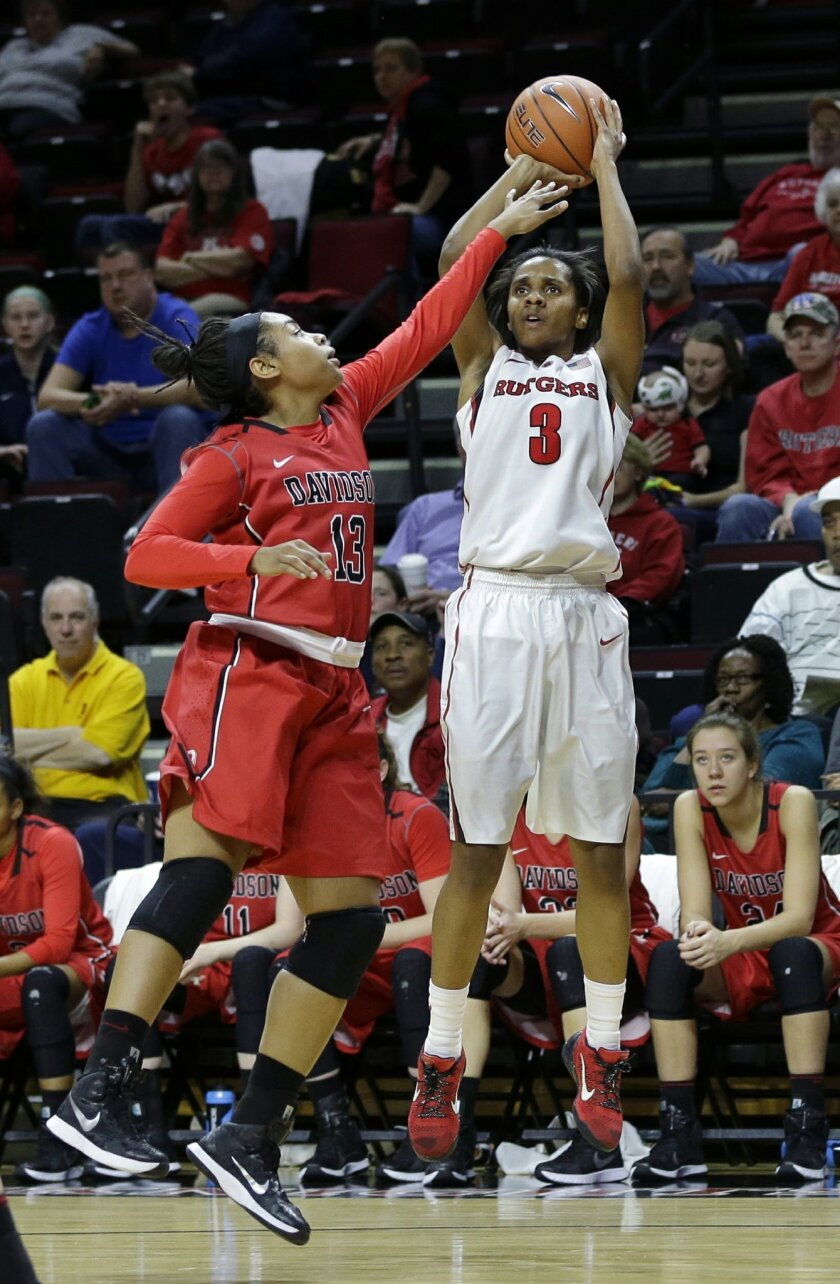 Rutgers' Tyler Scaife (3) shoots past Davidsons' Diona Johnson (13) during the first half of an NCAA college basketball game Sunday, Nov. 30, 2014, in Piscataway, N.J. (AP Photo/Mel Evans)