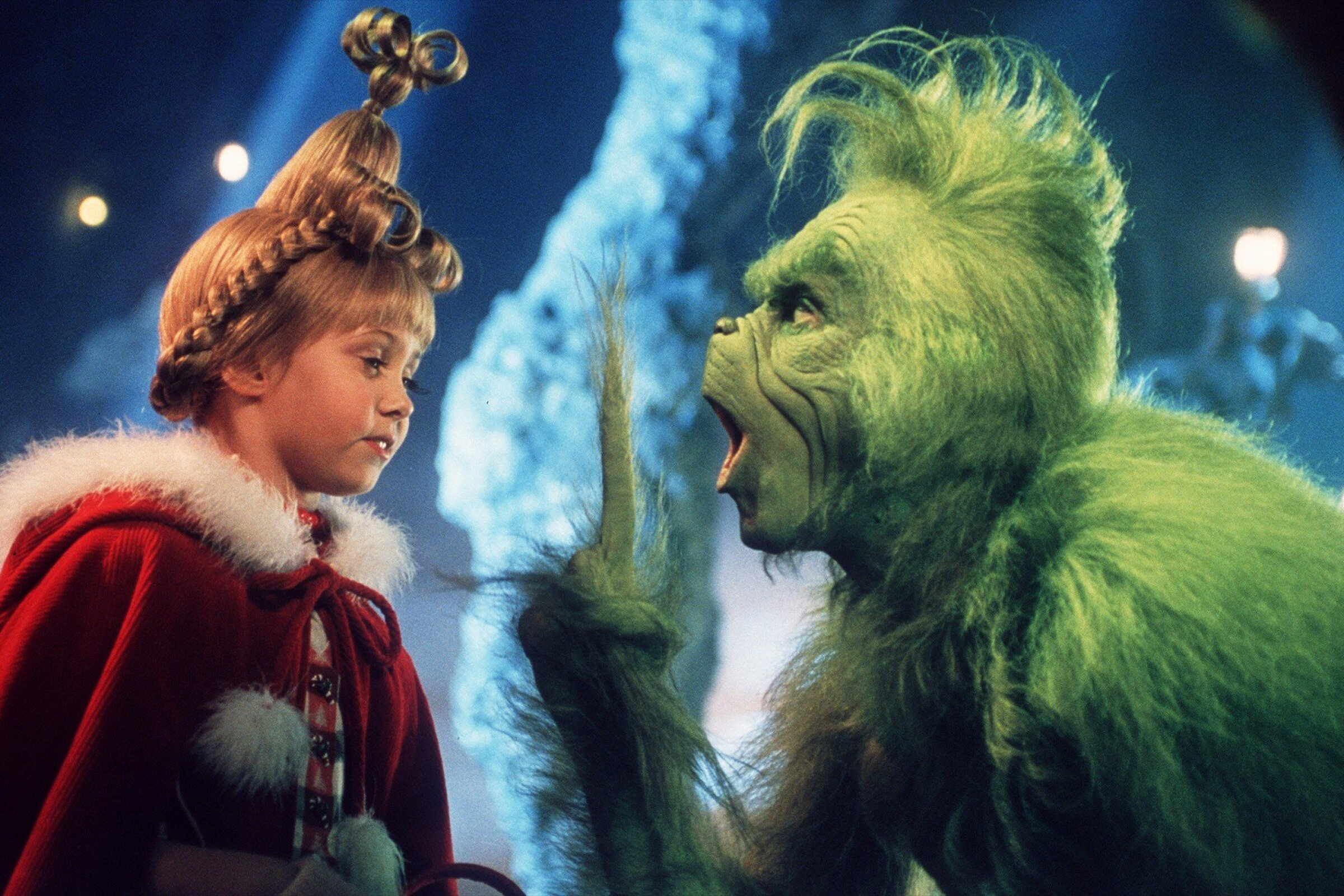 "Child actress Taylor Momsen as Cindy Lou Who, left, shares a scene with the Grinch, played by Jim Carrey in a scene from ""Dr. Seuss' How The Grinch Stole Christmas."""