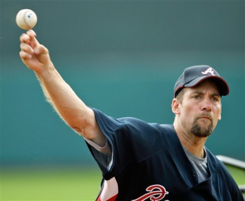 ** FILE ** Atlanta Braves pitcher John Smoltz throws during a Major League Baseball spring training workout in Lake Buena Vista, Fla., in this Feb. 18, 2008 file photo. Smoltz decided not to test his sore right shoulder Monday, March 24, 2008, opting to postpone a throwing session that could determine whether he opens the season on the disabled list.(AP Photo/David J. Phillip, File)