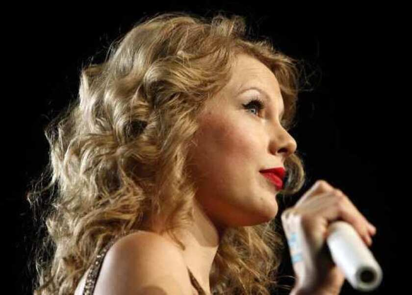 """Taylor Swift has released a new breakup song as the first single from her next album, """"Red,"""" due Oct. 22."""