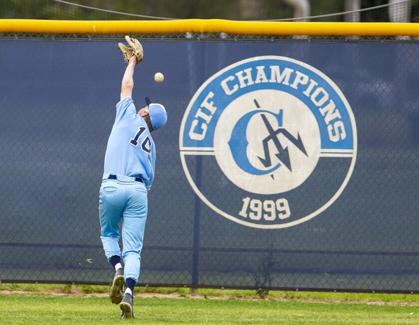 Corona del Mar's Carter Haight can't get to a ball hit by Edison's Blake Morton in the fifth during