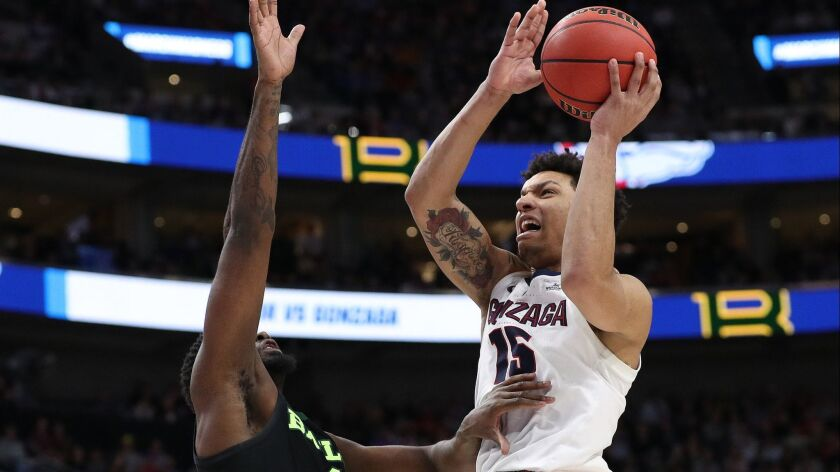 Gonzaga's Brandon Clarke (15) goes up for a shot against Baylor's Mario Kegler (4) during the second round of the NCAA tournament on Saturday in Salt Lake City.