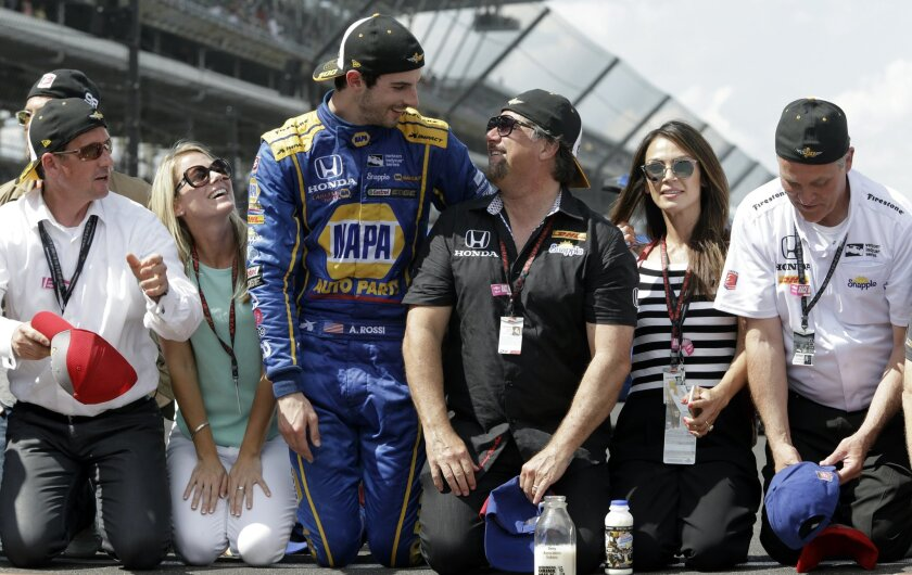 Alexander Rossi, center left,  celebrates with car owner Michael Andretti after winning the 100th running of the Indianapolis 500 auto race at Indianapolis Motor Speedway in Indianapolis, Sunday, May 29, 2016. (AP Photo/R Brent Smith)