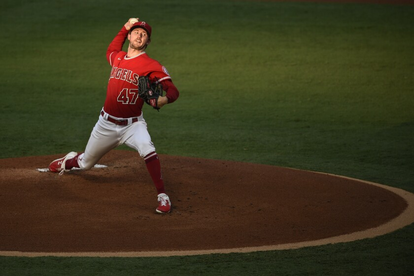 Angels starting pitcher Griffin Canning throws against the Giants.