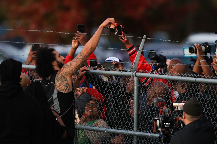 Colin Kaepernick interacts with fans and signs autographs.