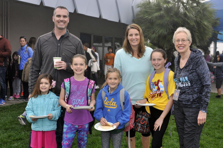 Scott Curry with Morgan and Sienna, mom Beth with Brigid and Kathryn, Principal Wendy Wardlow