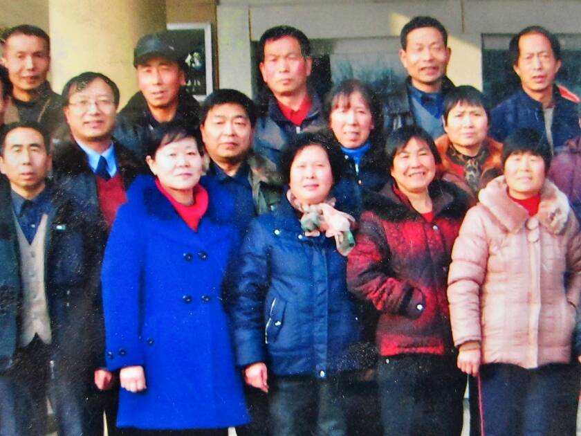 A photo taken at a high school reunion shows obstetrician Zhang Shuxia, left in the front row. She was arrested in July on suspicion of selling newborns to child traffickers.