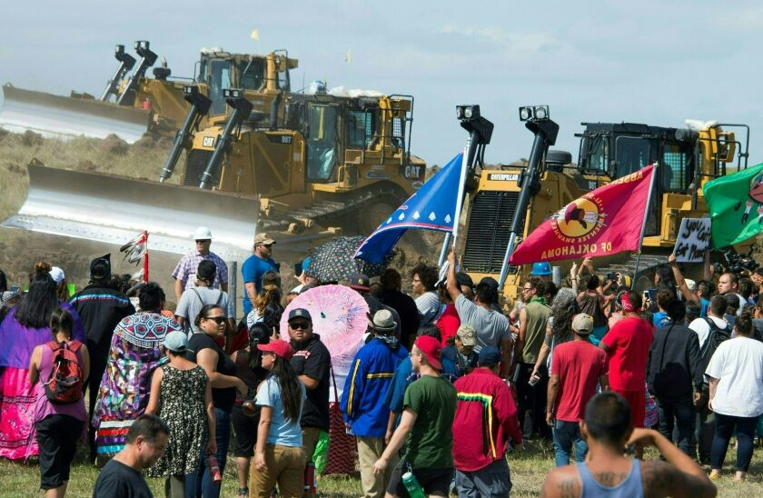 Members of the Standing Rock Sioux tribe and their supporters opposed to the Dakota Access pipeline confront bulldozers in September.