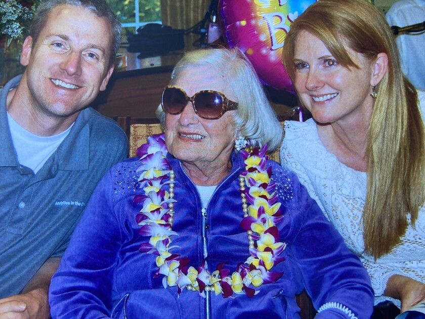 Janette Lalor, pictured during her 100th birthday celebration with her granddaughter and grandson-in-law.
