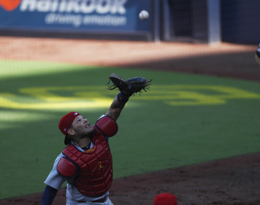 Yadier Molina of the St. Louis Cardinals catches ball off the bat of Manny Machado in the third inning.